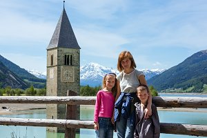 Family in summer Alps mountain.