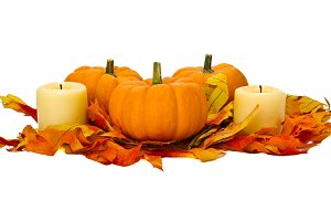 Small pumpkins and candles with fall