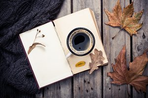 vintage book, knitted sweater with autumn leaves and coffee mug