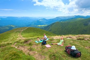 Family in summer Carpathian mountain
