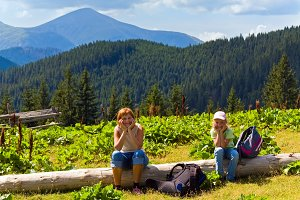 Family in summer Carpathian mountain