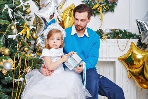 Father and daughter with gifts
