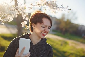 Girl laughs while holding phone