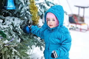 Girl decorates Christmas tree