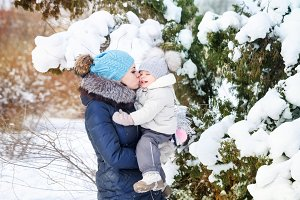 Mother and daughter in winter. Kiss