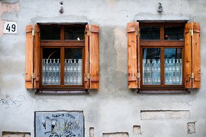 Two old windows with curtains