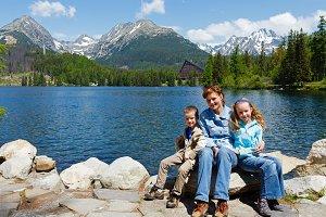 Family near summer lake
