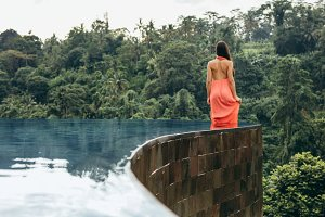 Young woman in infinity pool