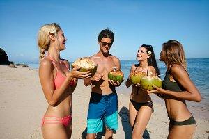 Friends drinking fresh coconut water