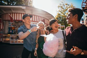 Group of friends eating candyfloss