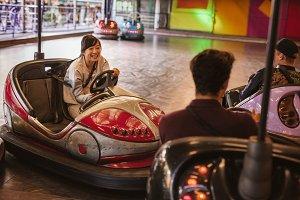 Friends having fun on bumper car