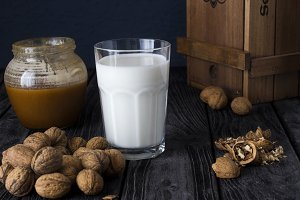 glass of milk with nuts and honey