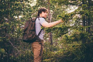 Young Man hiking in forest