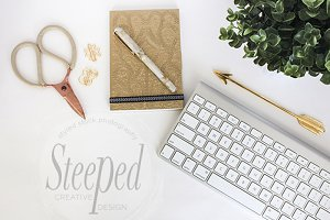 Gold notebook and keyboard desktop