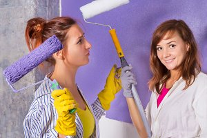 women paints white wall