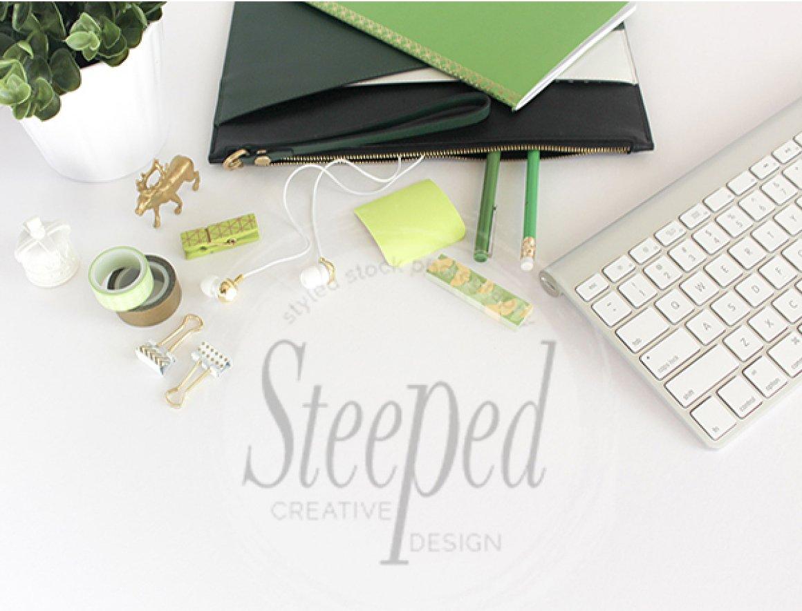 Green, white, desktop flatlay