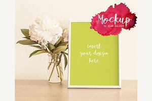 Mockup With White Frame And Peonies
