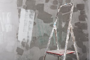 Old painted and stucco ladder concrete wall background