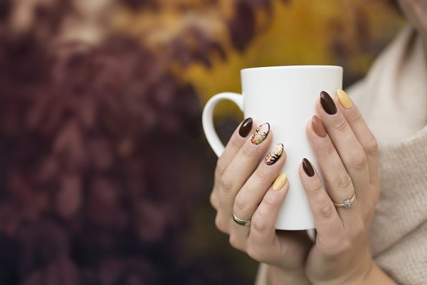 Hands of autumn nails