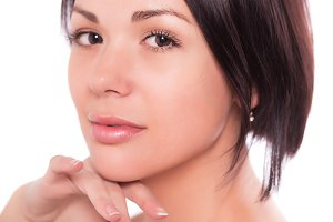 Slim young woman with nude make up skin care