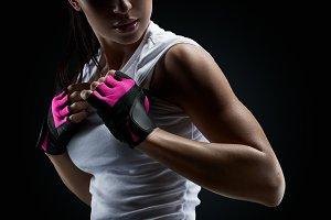 Bodybuilder wearing gloves