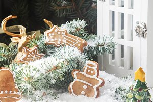 Merry christmas holiday decoration background with ginger man snowflakes snowman and tree cookies dry orange. Light wooden table. Space for text.
