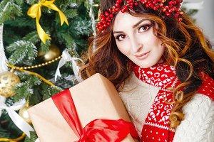 Girl holding a Christmas present