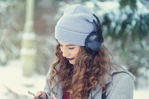 Hipster Girl listens to music