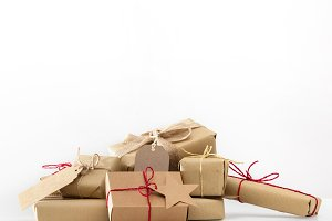 Rustic retro gifts, present boxes. Christmas time, eco paper wrap.