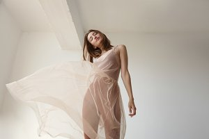 delicate woman in transparent dress