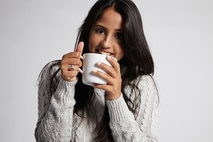 woman in grey sweater drink hot tea
