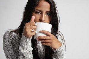 woman in grey sweater drink hot tea