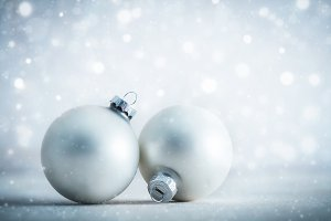 Christmas glass balls decoration on frosty glitter background