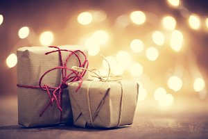 Rustic retro gifts, present boxes on glitter background. Christmas time