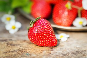 Perfect sweet ripe strawberries on wooden background