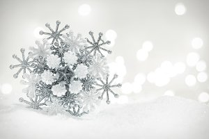 Winter snowflake decoration on glitter background.