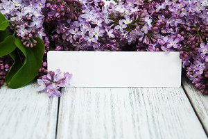 Lilac flowers with empty tag