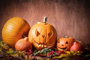 Halloween pumpkins, carved jack-o-lantern in fall leaves