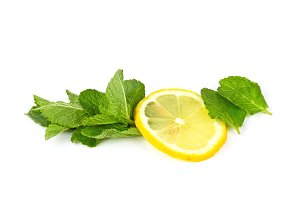 Slice of lemon with mint on white background