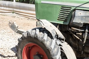 Tractor between greenhouses