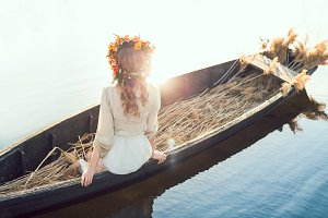 Beautiful girl sitting in the boat