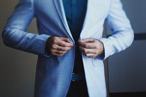 Man wears light blue jacket