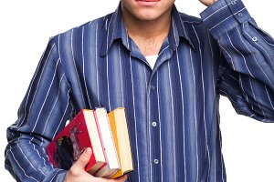 man in glasses with books