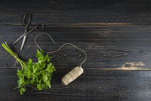 Bunch of parsley on dark wooden background