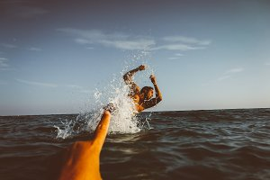 Man jumping in sea water