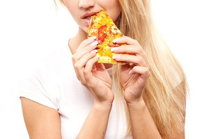 woman eatting piece of pizza
