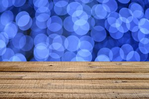 Wooden table with blue festive bokeh