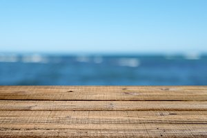 Wooden table with blue sea and sky