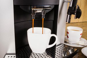 Coffee cup in machine