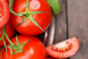 Fresh organic tomatoes in metal plate